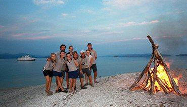 Crew on Beach with Fire