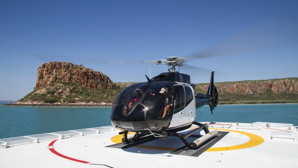 Enhance your cruise experience with a heli flight direct from the deck of TRUE NORTH!